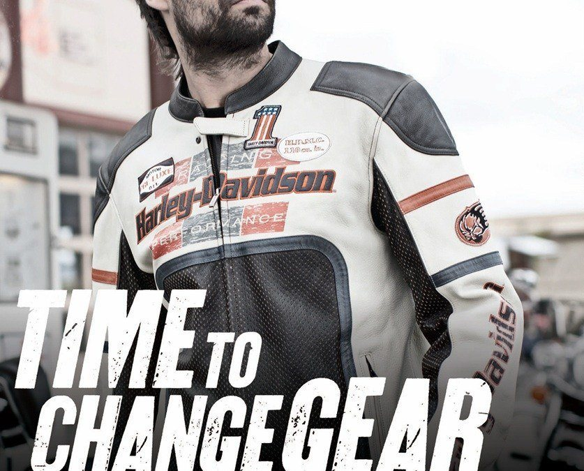 Man wears white and black Harley-Davidson racing jacket.
